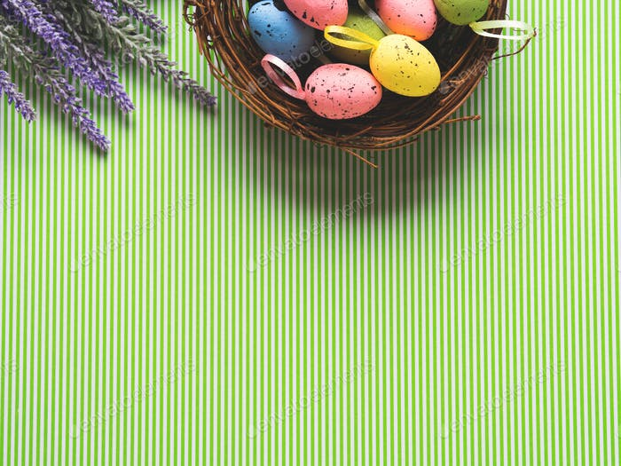 Easter background with Basket of decorative eggs