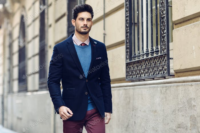 Attractive man wearing british elegant suit in the street. Moder