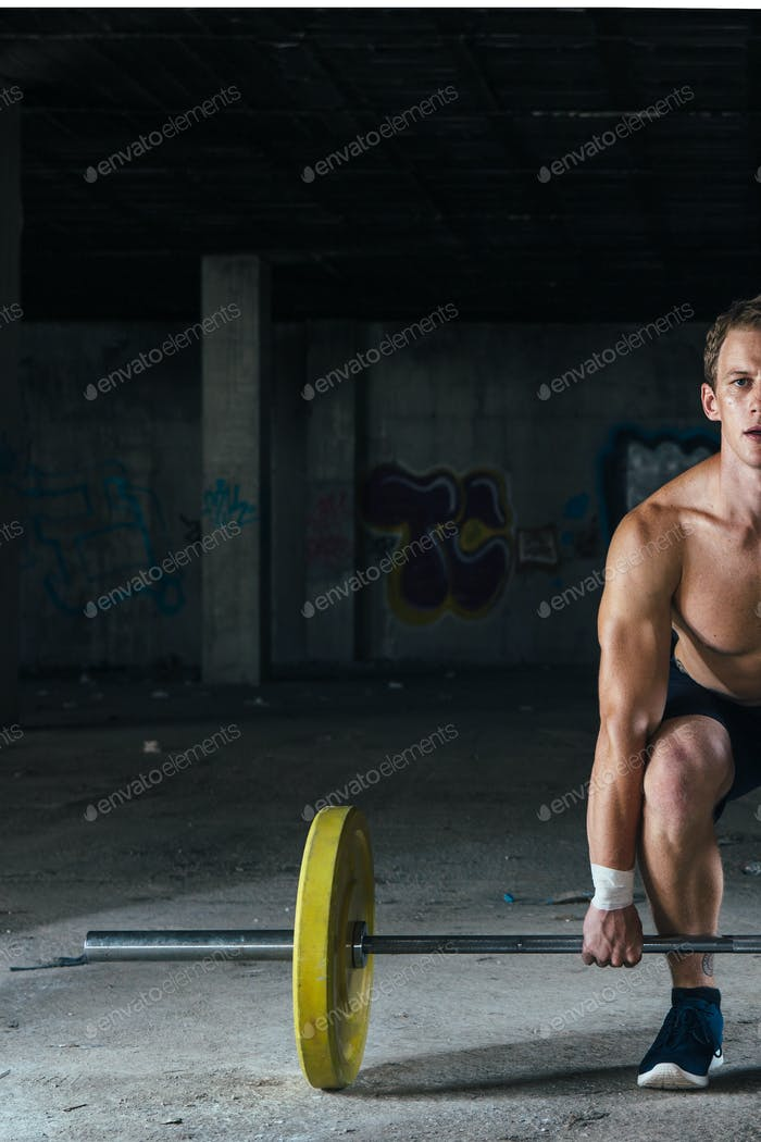 Man with naked torso working out