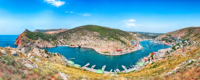 Panoramic view of Balaklava bay with yachts and ruines of Genoese fortress Chembalo in Sevastopol
