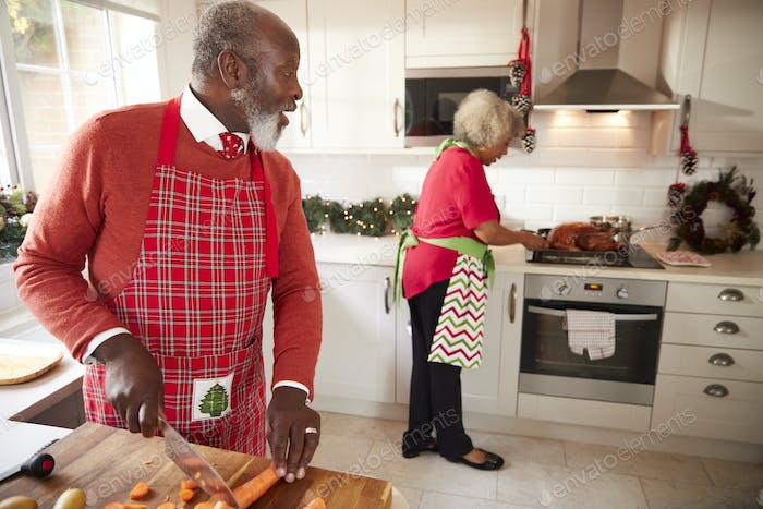 Mature black couple preparing Christmas dinner