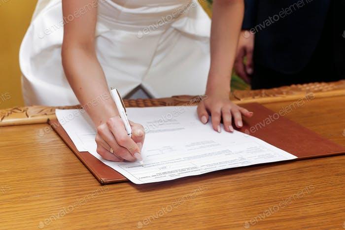 elegant gorgeous bride signing register