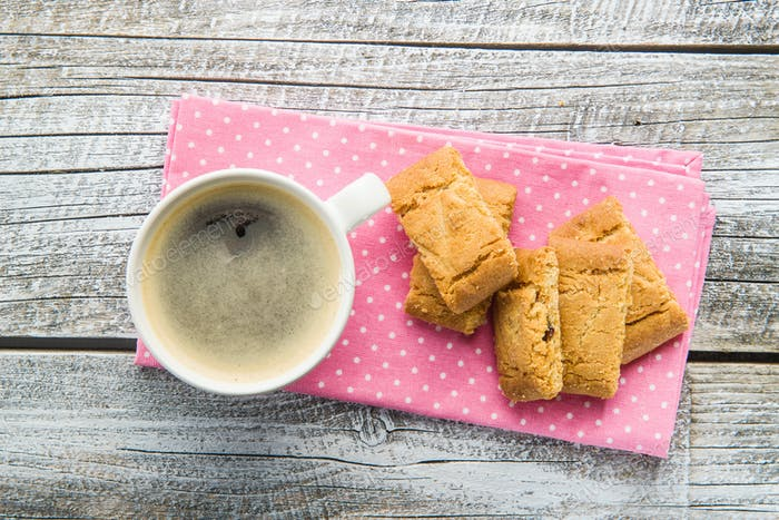 Sweet cookies and coffee cup.