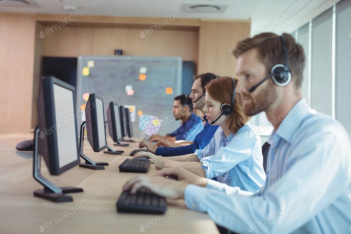 Side view of business people working at call center