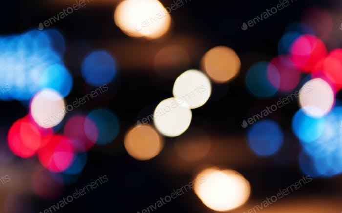 Blurred street bokeh lights at night time
