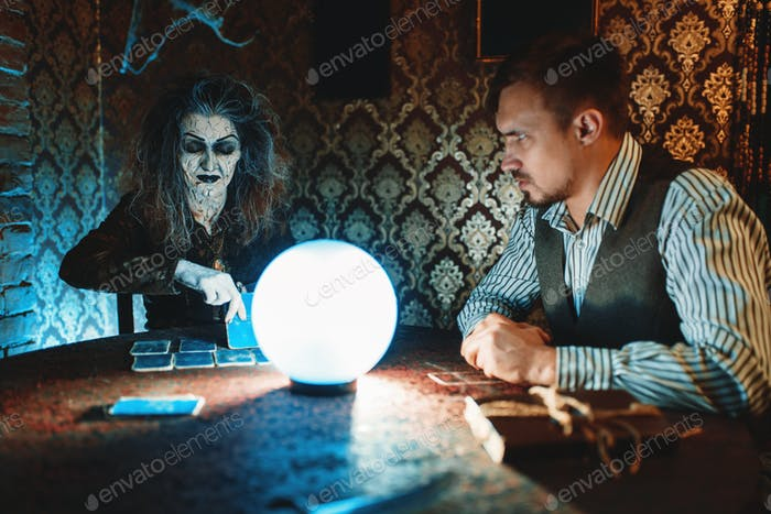Young couple and fortune teller, spiritual seance