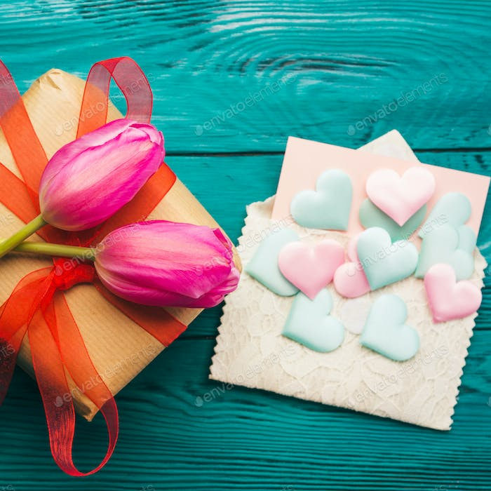 Gift box with tulips and hearts. Valentine's day