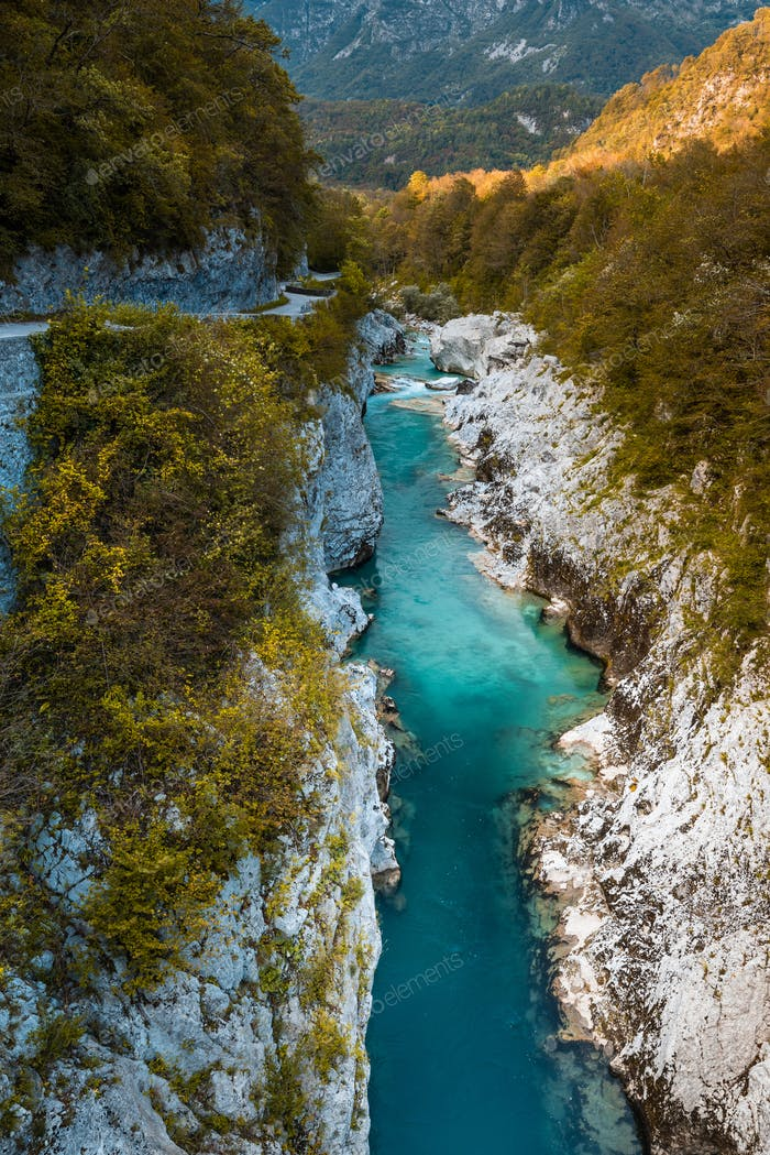 Emerald Green Soca River in Slovenia. Atumnal Foliage Colors