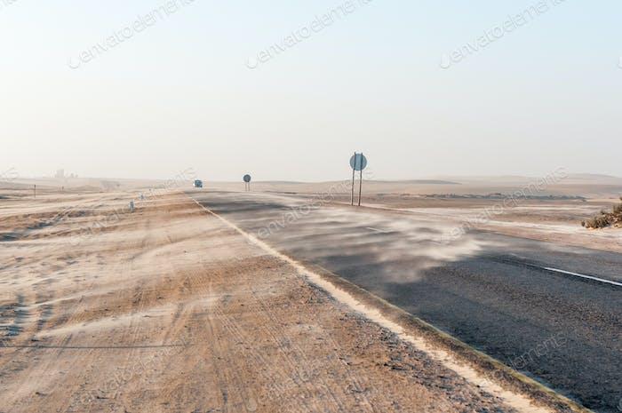 Sand blown over road near Longbeach in the Namib Desert