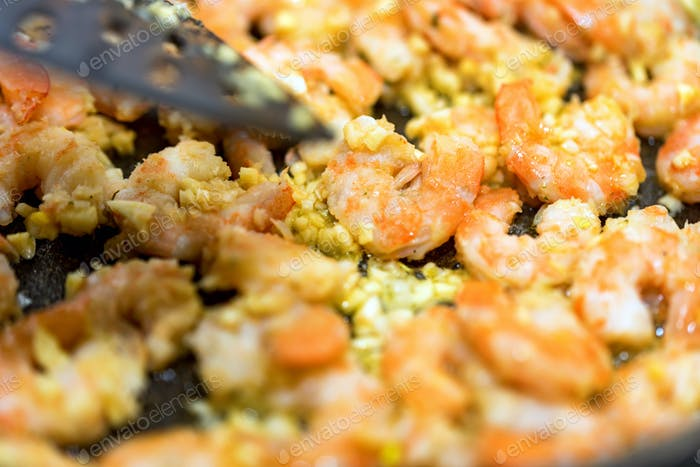 Close-up of shrimps fried in a frying pan
