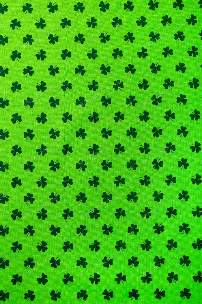 Shamrock pattern green textile. St. Patrick's Day background. Copy space. Top view