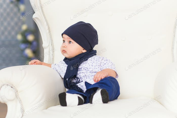 Portrait of a cute baby boy sitting and smiling. Adorable four month old child.