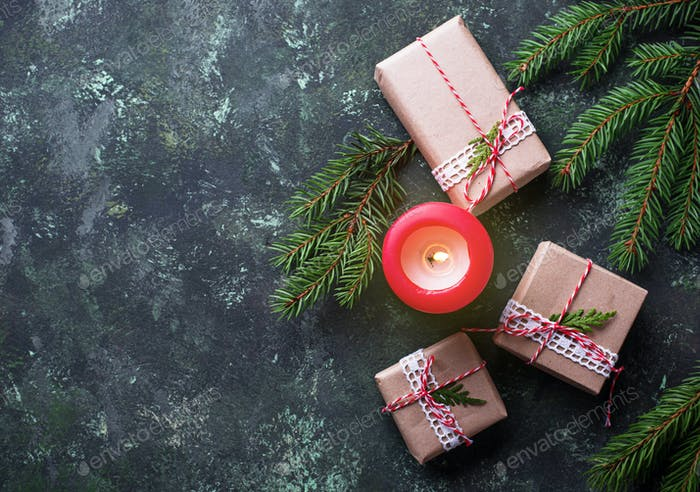 Christmas background with gift boxes and candle