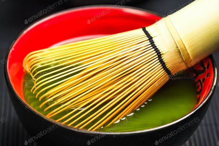 Traditional bamboo whisk and matcha tea
