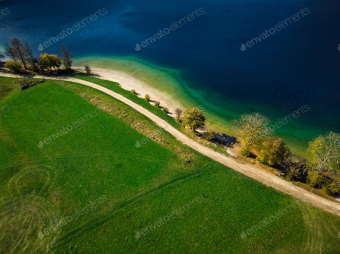 Vibrant colors of nature at Bohijn lake in Slovenia, drone view