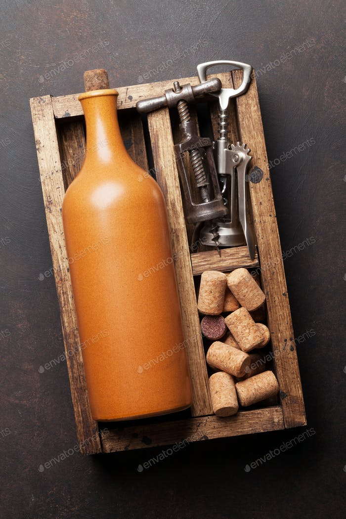 Wine bottle, corkscrew and corks