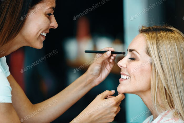 Portrait of beautiful woman getting cosmetic care at beauty salo