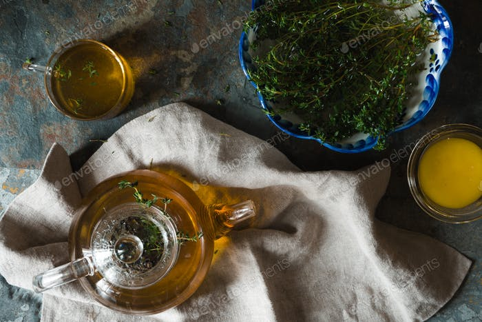 Tea ceremony with thyme and honey on the slate