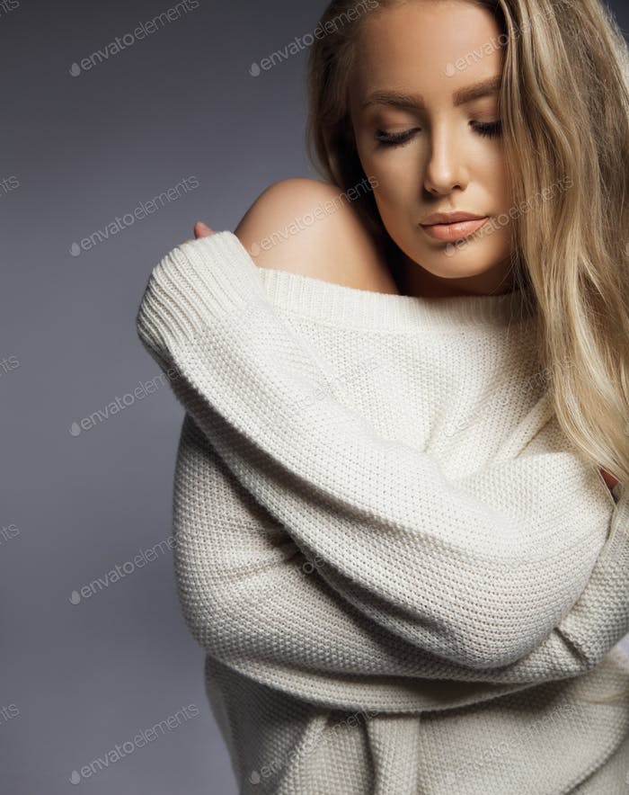 Sensual sexy model in oversized sweater