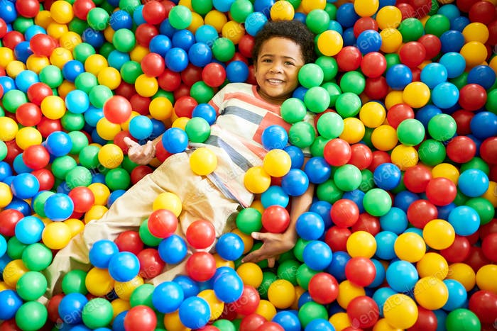 African-American Boy Playing in Ballpit