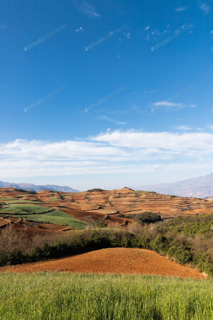 beautiful red land against a blue sky in dongchuan district