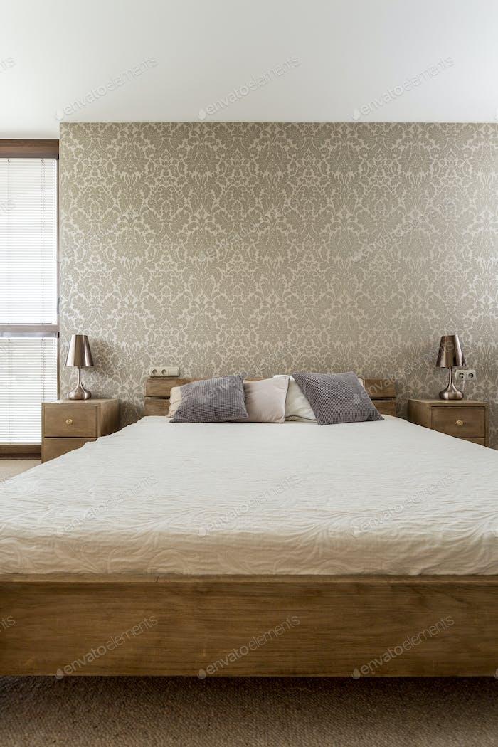 Wooden bed in modern brown bedroom