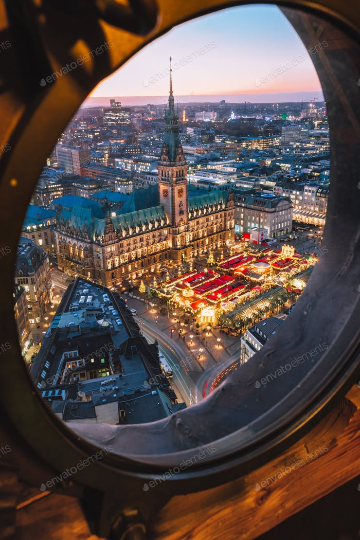Top view of illuminated Christmas market on townhall square in advent time, Hamburg, Germany
