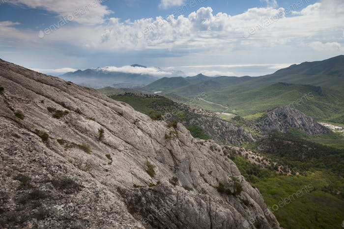 Crimean mountains under the blue sky with clouds