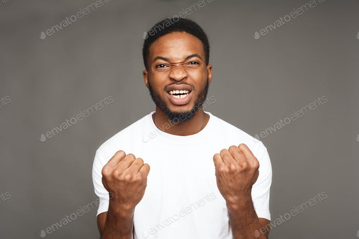 Success, excited black man with happy facial expression
