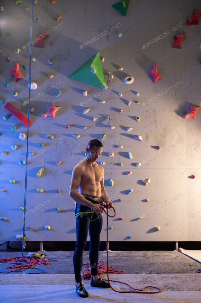 Professional climber preparing for bouldering workout