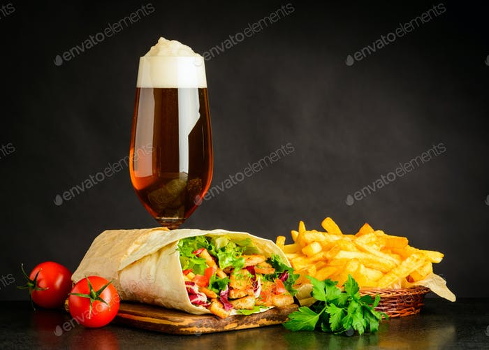 Glass Beer with Shawarma Sandwich and Fries