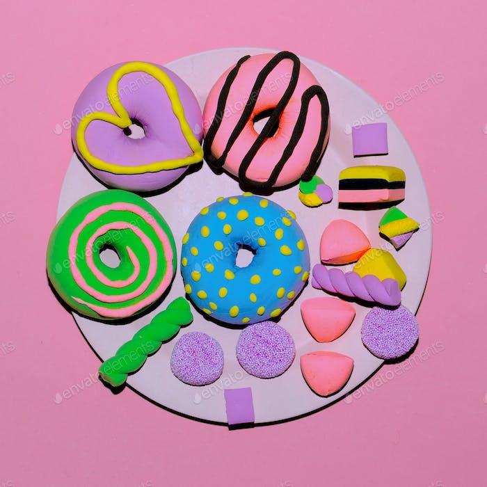 Set Creative Donuts and sweets. Flat lay candy minimal art