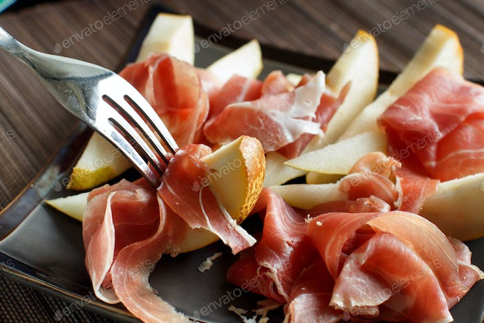 Appetizer with pear and italian parma ham