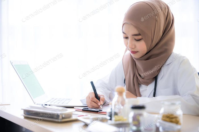 The muslim woman doctor record and note diagnostic result exam and medical history