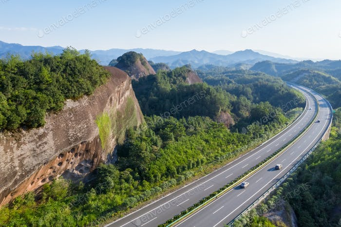 highway in mountainous area with danxia landform