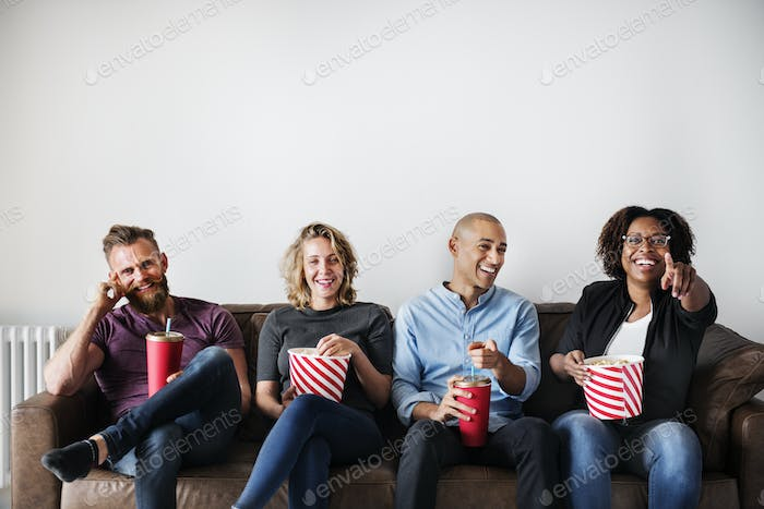 Group of friends having a great time watching movie