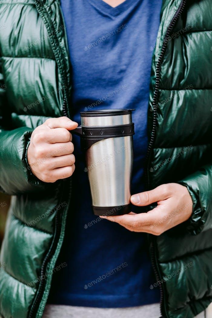 Placeit Man Holding Coffee Mug mockup outdoors