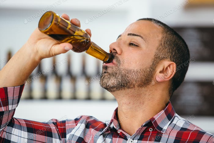 Man drinking bottled beer