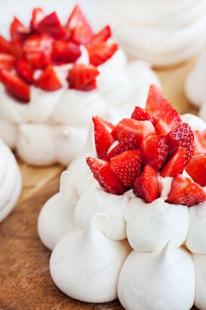 Pavlova meringue cake decorated with fresh strawberries