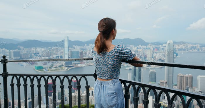 Woman enjoy the city view in Hong Kong