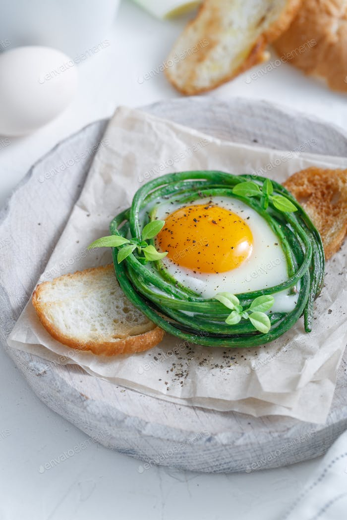 Green bean nest with fried egg on toasted bread