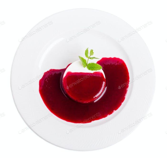 Vanilla panna cotta with raspberry jam.