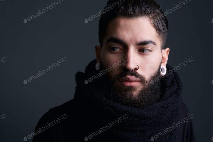 Modern young man with beard and piercings