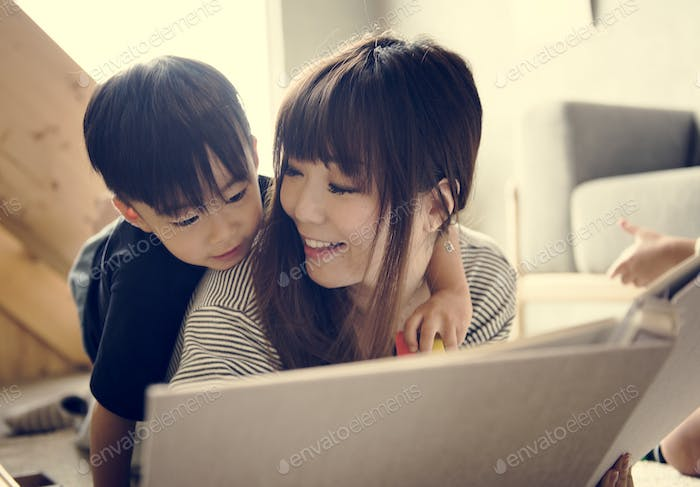 Japanese mother and son playing