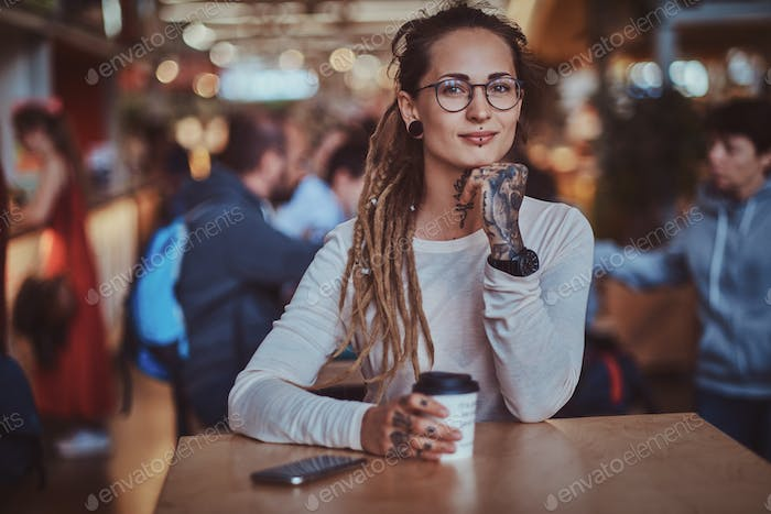 Portrait of pretty young woman with cup of coffee