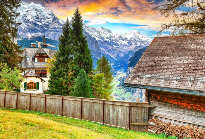 Fantastic autumn view of traditional swiss chalets in Wengen village