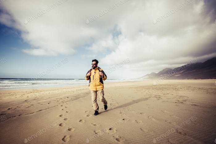 Travel and freedom adventure people man concept with wanderlust backpacker walking