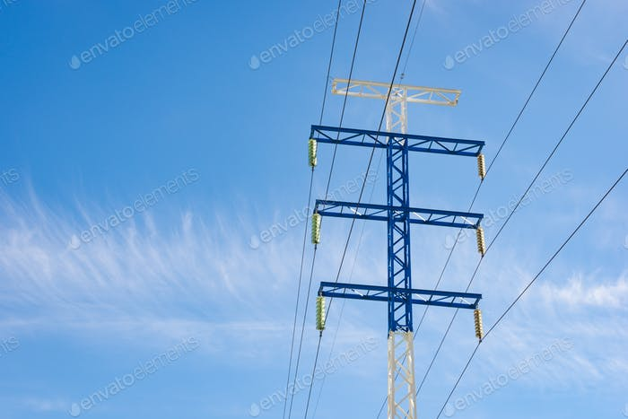 a high-voltage electricity pylons against blue sky and clouds power line electric post