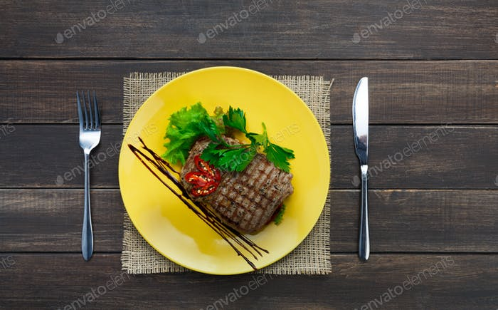Restaurant food top view on wooden table. Perfect beef steak