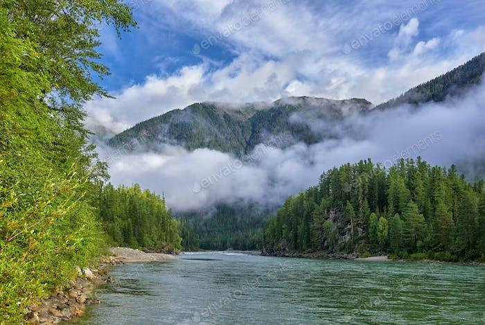 Fog over Siberian River in August
